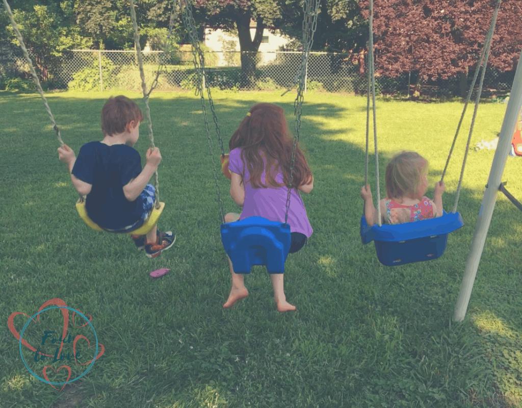 Kids playing on a swingset