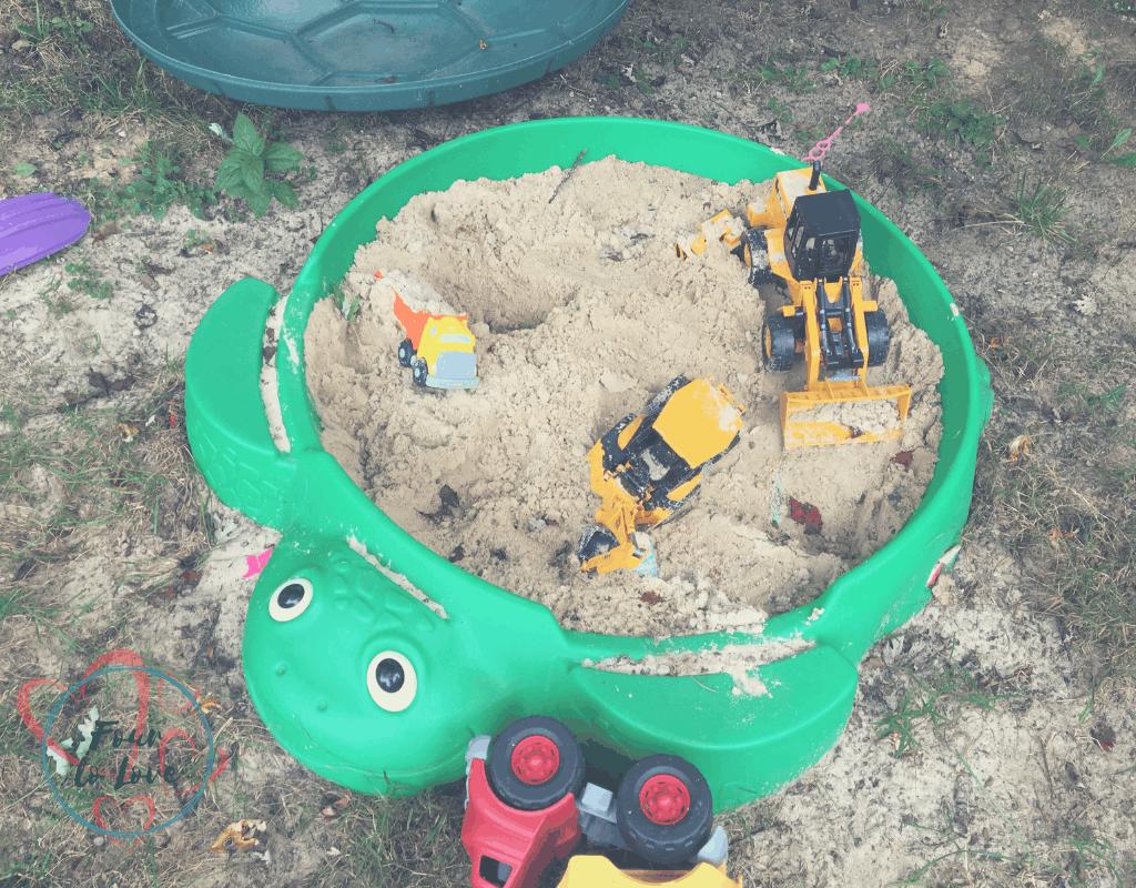Outdoor toys in a sandbox