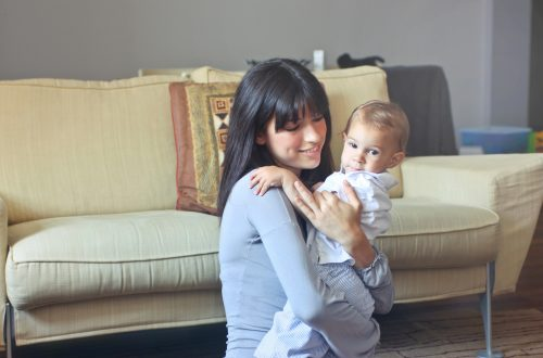 Woman looking relaxed and smiling with her child
