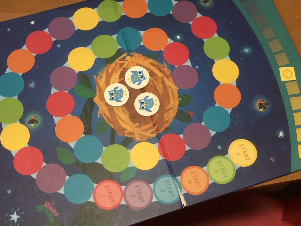 Picture shows gameplay of Owl Hoot, a cooperative board for kindergartners