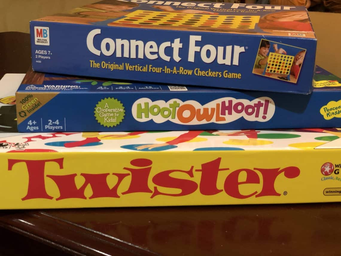 Three of the best games for kindergartners stacked together.