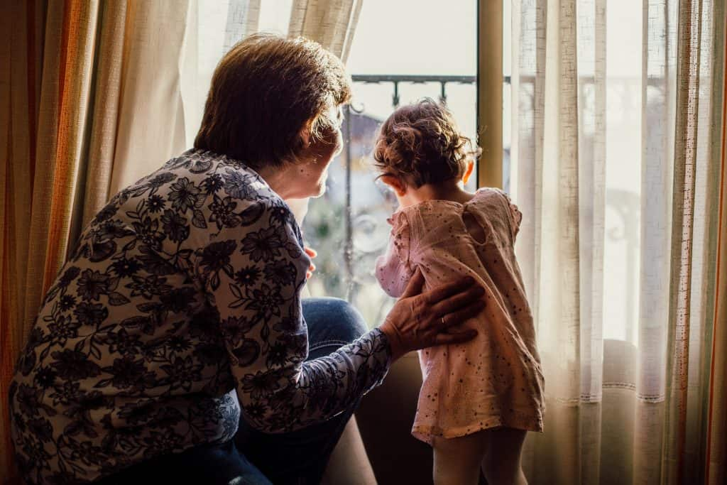 Grandma with grandchild near window