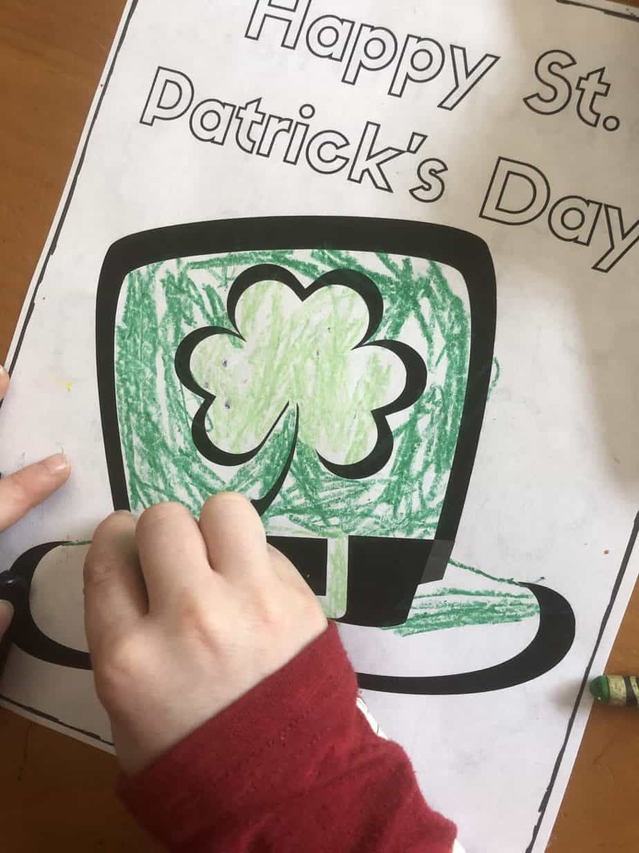 Kid coloring a St. Patrick's Day coloring page of a leprechaun hat