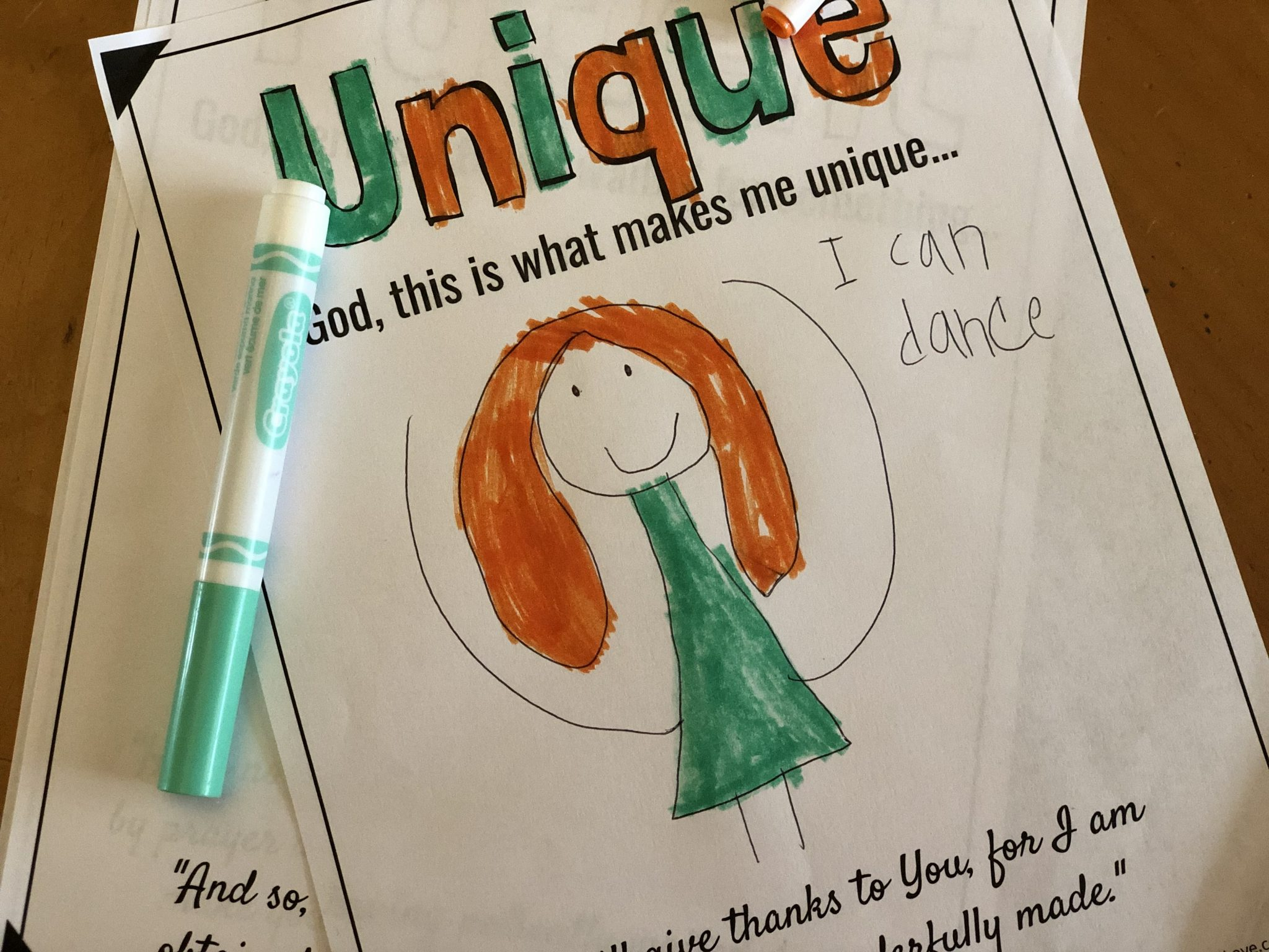 "A completed Bible coloring page featuring the word ""unique"" and a drawing of a dancer."