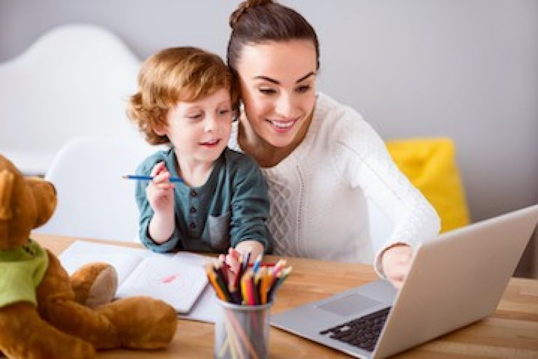Mother and child looking at laptop